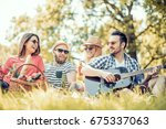 happy young friends having fun... | Shutterstock . vector #675337063