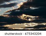 Dark Cloudy Sky With Sunset On...
