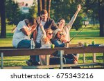 multi ethnic group of friends... | Shutterstock . vector #675343216