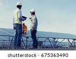 team engineers checking solar... | Shutterstock . vector #675363490