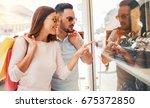 beautiful young couple enjoying ...   Shutterstock . vector #675372850