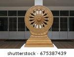 wheel of dharma texture or... | Shutterstock . vector #675387439