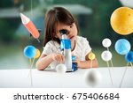 curious little girl looking... | Shutterstock . vector #675406684
