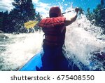 rear view of a male kayaker... | Shutterstock . vector #675408550