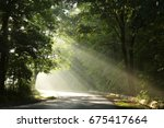 rural road through the forest... | Shutterstock . vector #675417664