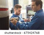 focused precise man undoing the ... | Shutterstock . vector #675424768