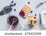 homemade belgian waffles with...   Shutterstock . vector #675425350