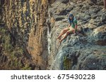 the guy is sitting on the edge...   Shutterstock . vector #675430228