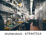 empty restaurant kitchen is... | Shutterstock . vector #675447514