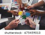 businessmen building colored... | Shutterstock . vector #675459013