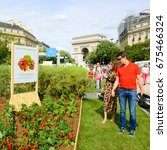 Small photo of PARIS, FRANCE - JUNE 4, 2017 - Visitors at BiodiversiTerre event (created by Gad Weil) showing relationship of mankind with nature in today's society. Triumph Arch at background.