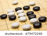 board game go or wei chi with... | Shutterstock . vector #675472240