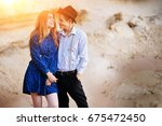 an attractive man hugs a... | Shutterstock . vector #675472450