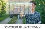 futuristic young farmer ... | Shutterstock . vector #675499270