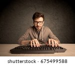 a young hacker with glasses... | Shutterstock . vector #675499588