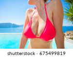 big boobs in pink bikini | Shutterstock . vector #675499819