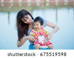 smiling mother and baby playing ... | Shutterstock . vector #675519598
