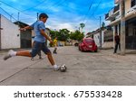 boys playing football in the...   Shutterstock . vector #675533428
