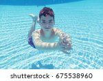 boy  diving underwater at spa... | Shutterstock . vector #675538960