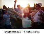 happy cheerful friends spending ...   Shutterstock . vector #675587548