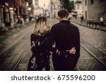 stylish gypsy couple in love... | Shutterstock . vector #675596200