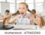 red haired young schoolgirl...   Shutterstock . vector #675602560