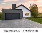 stylish house with garage and... | Shutterstock . vector #675604528
