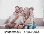 family portrait of four. happy... | Shutterstock . vector #675610066