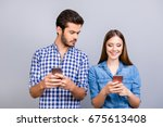 curious boyfriend is spying his ... | Shutterstock . vector #675613408
