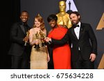 Small photo of LOS ANGELES, CA - FEBRUARY 26, 2017: Mahershala Ali, Emma Stone, Viola Davis & Casey Affleck in the photo room at the 89th Annual Academy Awards at Dolby Theatre, Los Angeles