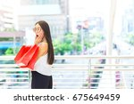 beautiful young woman hold... | Shutterstock . vector #675649459