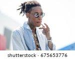 rapper wiz khalifa attends and...   Shutterstock . vector #675653776
