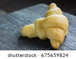 tasty buttery croissants on old ... | Shutterstock . vector #675659824