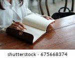 top view. hand of student asia... | Shutterstock . vector #675668374
