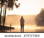 silhouette alone woman standing ... | Shutterstock . vector #675717304