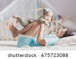 mother play with her baby after ... | Shutterstock . vector #675723088