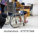 woman on wheelchair wait doctor ... | Shutterstock . vector #675737368