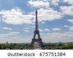 eiffel tower against blue sky... | Shutterstock . vector #675751384