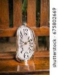 distorted soft melting clock on ...   Shutterstock . vector #675802669