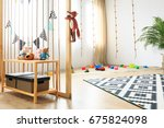 spacious wooden room with toys... | Shutterstock . vector #675824098