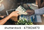man offering batch of hundred... | Shutterstock . vector #675826873