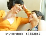 Asian ethnic mother enjoy having conversation with teenage daughter - stock photo