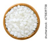 Small photo of White onion cubes in wooden bowl. Chopped fresh, raw Allium cepa, also bulb or common onion. Vegetable, ingredient and staple food. Isolated macro food photo close up from above on white background.