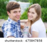 blurred couple making selfie at ... | Shutterstock . vector #675847858
