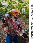 Small photo of Young, experienced logger with chainsaw holds a cut piece of wood