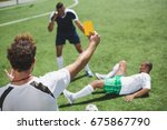 back view of soccer referee... | Shutterstock . vector #675867790