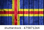 Small photo of Flag of Aland on a wooden background