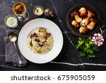risotto with porcini mushroom... | Shutterstock . vector #675905059