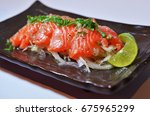 salmon japanese spicy salad dish | Shutterstock . vector #675965299