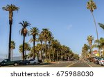 palm tree lined ocean avenue... | Shutterstock . vector #675988030